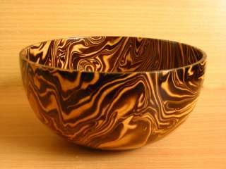 is a beautiful wooden bowl made of mango wood safe for food real usage